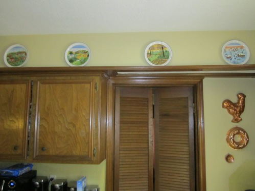 French plates representing the seasons along the plate rail.